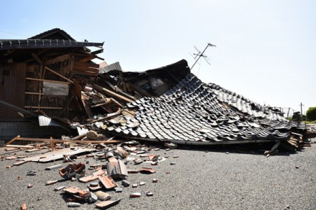 MASHIKI, JAPAN - APRIL 15: A house is seen collapsed after the earthquake on April 15, 2016 in Mashiki, Kumamoto, Japan. As of April 15 morning, at least nine people died in the powerful earthquake with a preliminary magnitude of 6.4 that struck Kumamoto Prefecture on April 14, 2016.  (Photo by Masterpress/Getty Images)